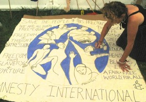 Painting banners for Amnesty at WOMAD festival